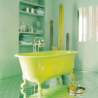 And when I'm all grown up I want a bathroom with a yellow floor. Or a minty-green bathroom with a yellow bath. Via Marie-Claire.